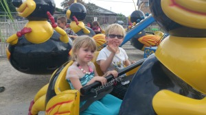 Molly and Ben riding the bumblebees at the fair www.picklesINK.com