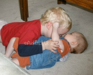 Toddler and baby hugging - awwww!