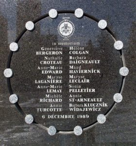 Plaque on the exterior wall of École Polytechnique commemorating the victims of the massacre.